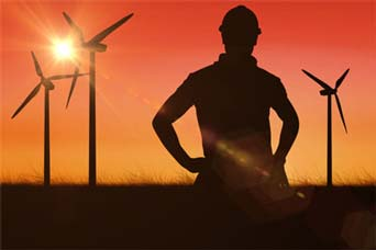 image of man standing in front of wind farm